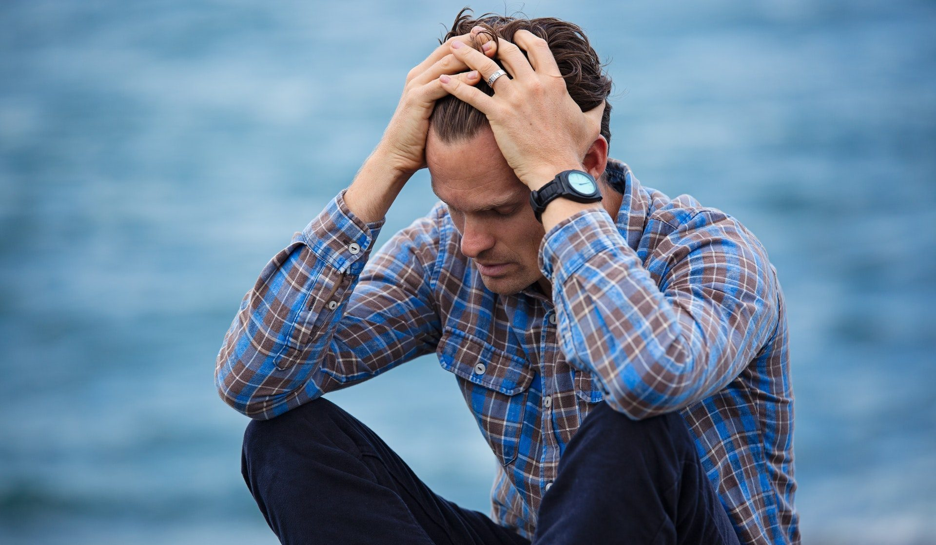 post holiday blues Man in Blue Environment Looking Distressed